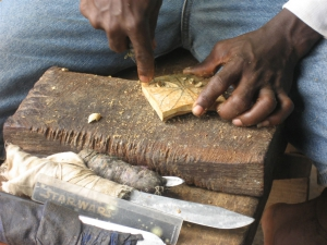 Removing larger pieces in carving an adinkra stamp