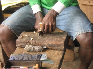 Cutting the adinkra gourd