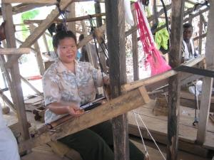 Tien in a Ghanaian loom.