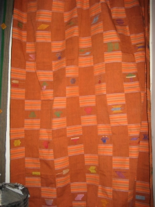 An orange kente