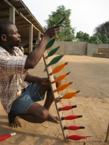 Rack of Bobbins for Kente Weaving