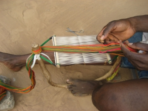 Threading the Heddles for Kente Weaving
