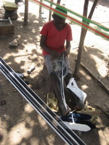 Sleying the reed for kente weaving
