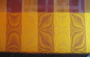 goldenrod shawl on the loom.