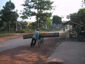 Man Carrying Large Load On Bicycle In Hanoi