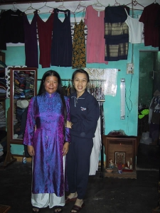 Tien in ao dai with Tailor-shop Owner