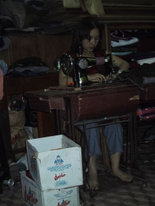 Woman Sewing in Vietnam Tailor Shop
