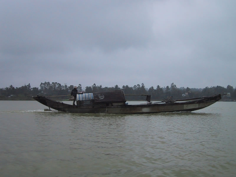 Fisherman's Boat On The River