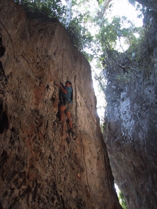 Tien Climbing Rock Wall During Climbing Lesson