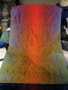 View of the Ocean Sunset II shawl before wet-finishing