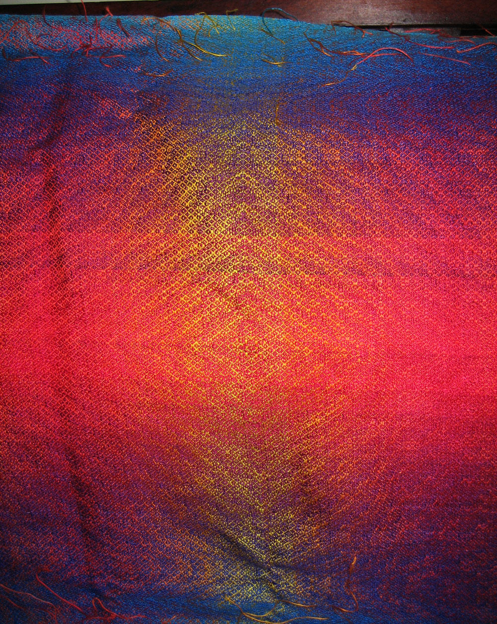closeup of the unfinished ocean sunset shawl