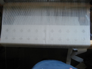 The shawl on the loom.