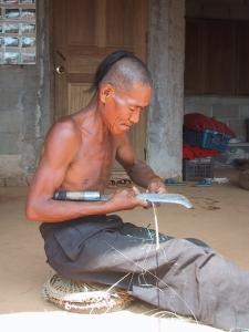 Akha Man Making Bamboo Ties