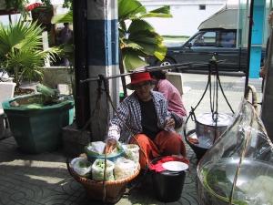 Bangkok Woman With Baskets