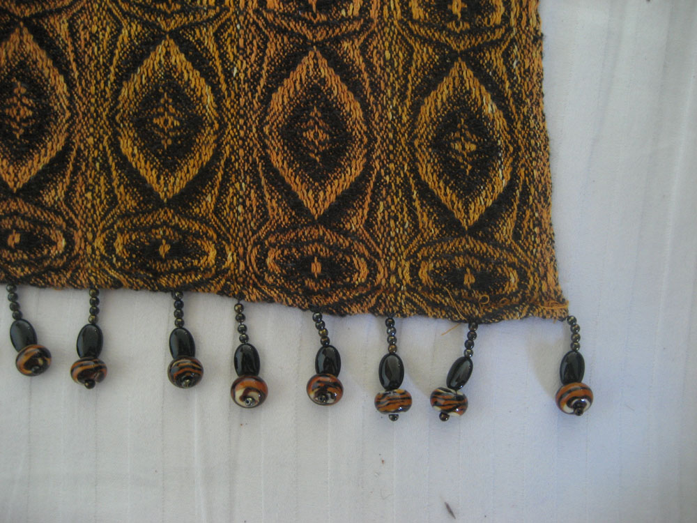 A closeup of the tiger eye pattern, showing off the beads.