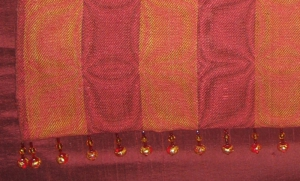 Closeup of the garnet shawl, showing the beads.