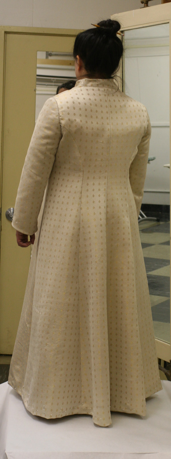 Rear view of the partially finished handwoven wedding coat