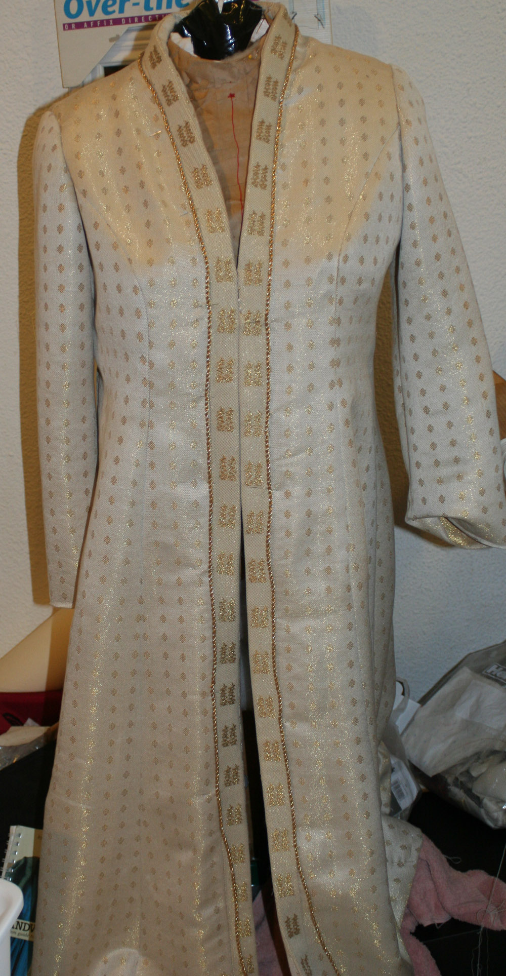 Handwoven wedding coat with double-happiness ribbon