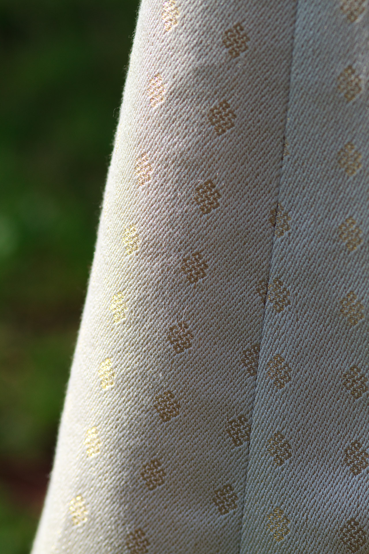 Closeup of pattern in handwoven wedding dress