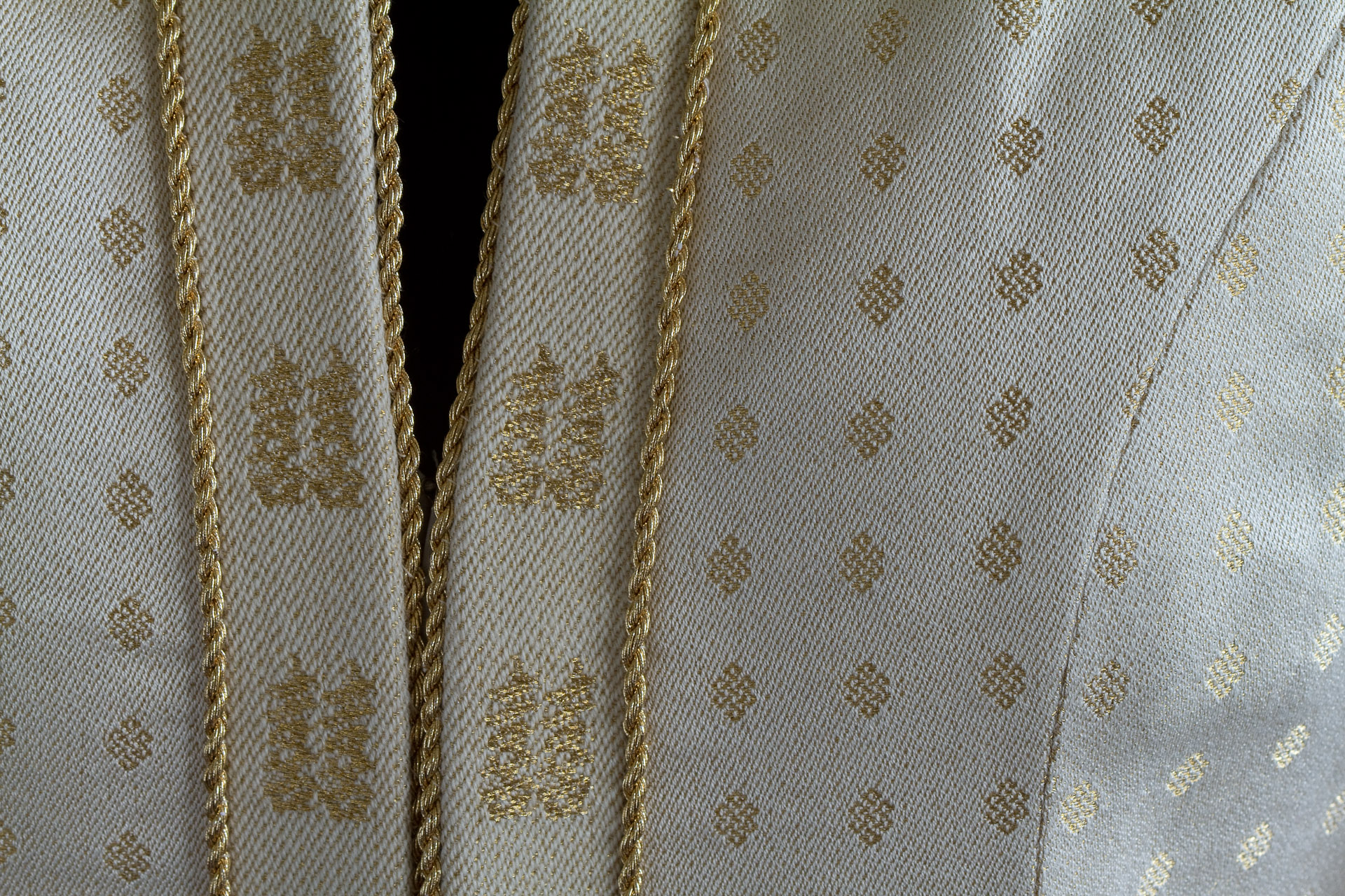 Closeup of front opening in handwoven wedding dress