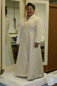 A front view of the partially finished handwoven wedding-coat