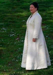 three-quarter view of handwoven wedding dress / coat