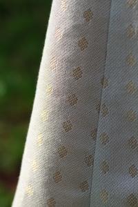 Closeup of pattern in handwoven wedding dress