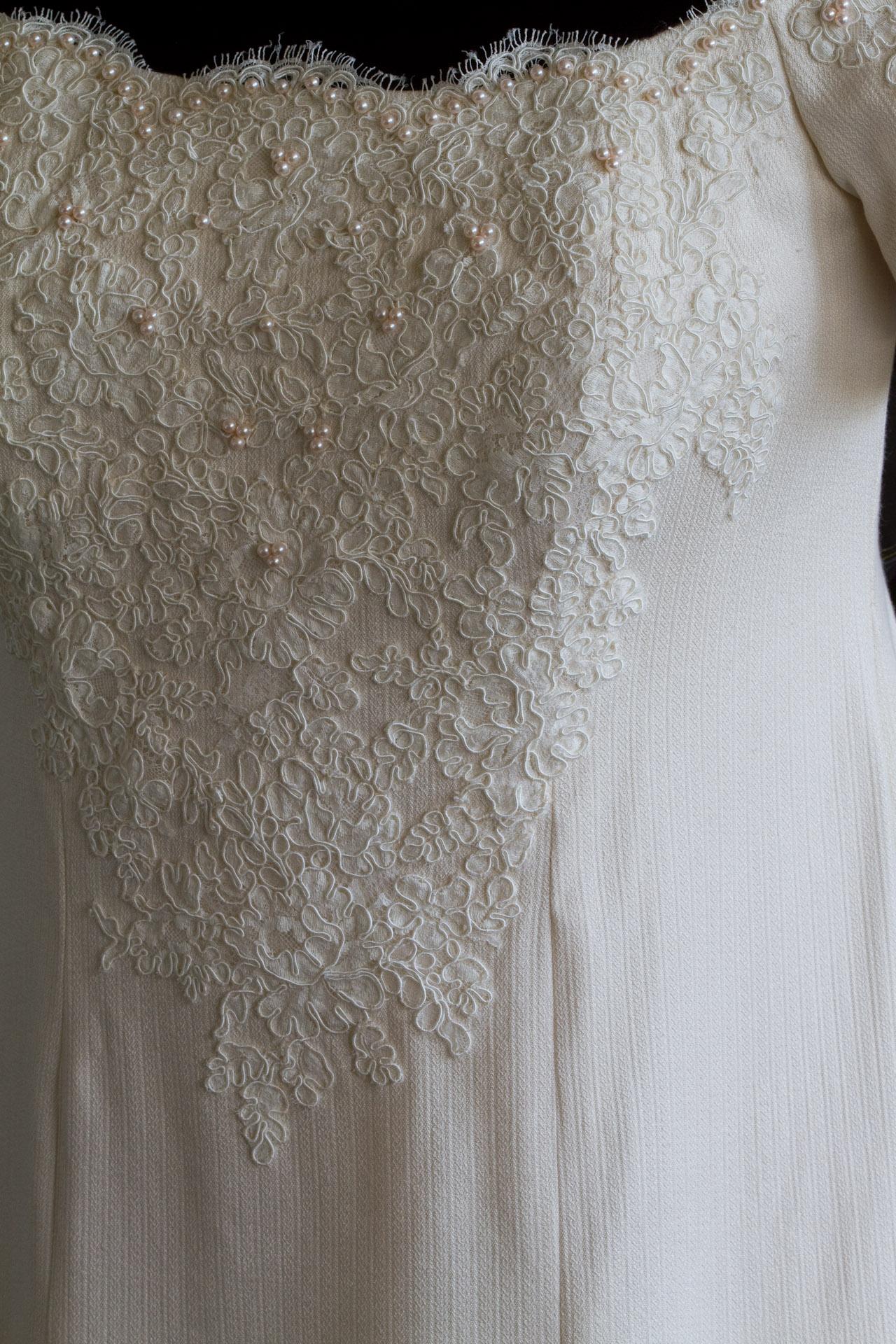 closeup of handwoven wedding dress, on dress form