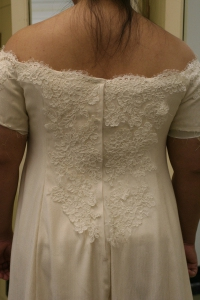 Partially completed handwoven wedding dress, with the back lace basted on.