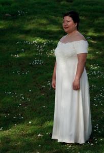 three-quarter view of handwoven wedding dress