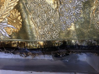 selvedge of lacquered paper weaving