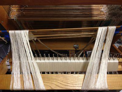 24 inch wide warp, 10 yards, on the warp beam